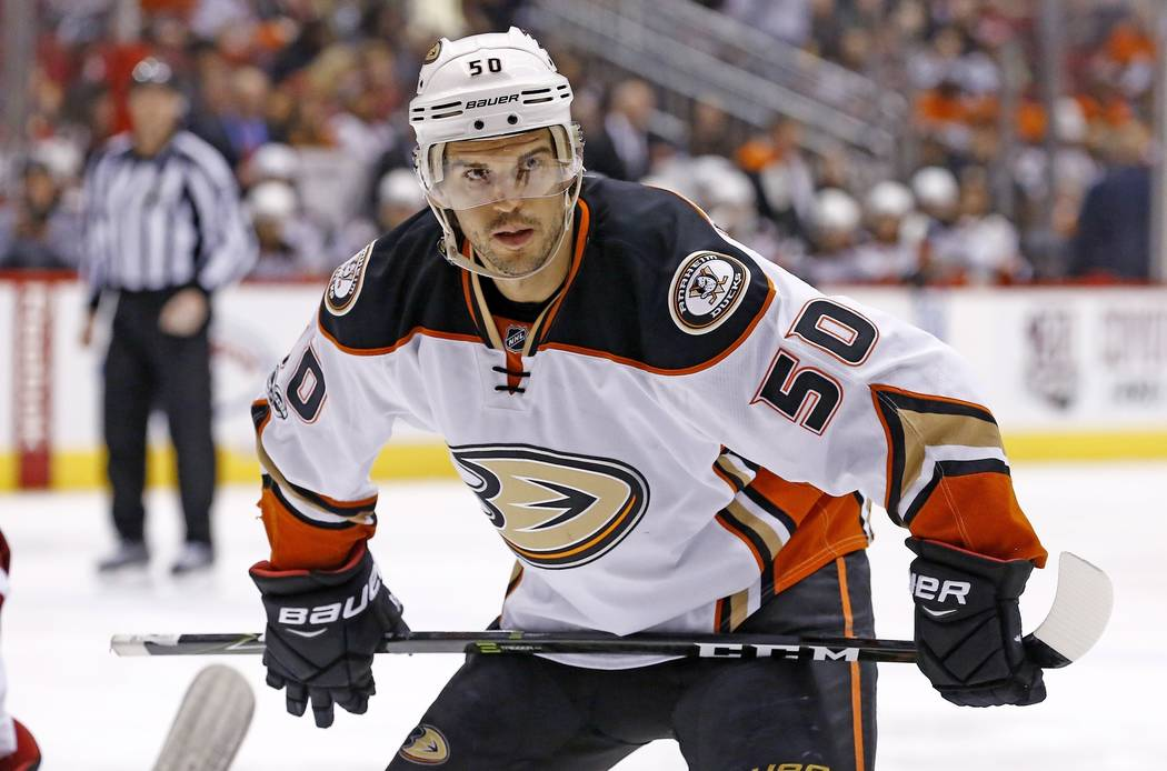In this Jan. 14, 2017, file photo, Anaheim Ducks center Antoine Vermette pauses before a faceoff during the first period of an NHL hockey game against the Arizona Coyotes in Glendale, Ariz. Vermet ...