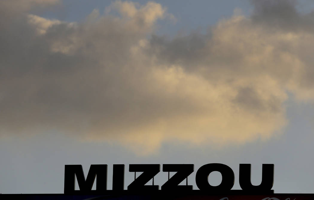 In this Nov. 2, 2013, file photo, the Mizzou logo is seen on a scoreboard over Memorial Stadium at Faurot Field before the start of an NCAA college football game between Missouri and Tennessee in ...