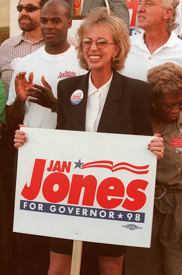 Former Las Vegas Mayor Jan Jones Blackhurst holds a campaign sign after announcing her bid for governor at her campaign headquarters in Las Vegas in spring 1998. In January of that year, she was d ...