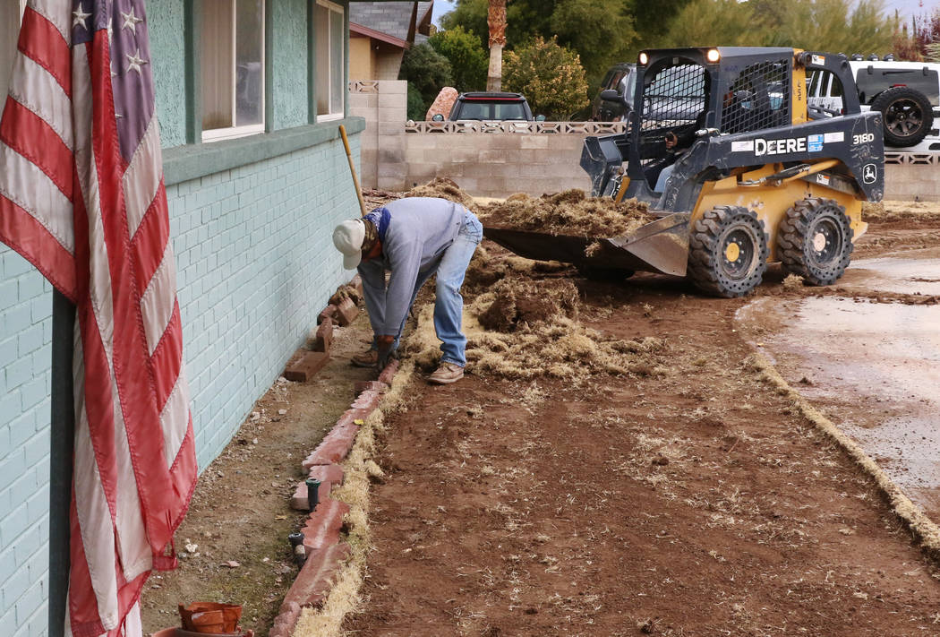 Rodolfo Ramos of North West Landscape, removes old lawn from Mary Kiosowski Lewis', not photographed, front yard on Monday, Dec. 10, 2018. Bizuayehu Tesfaye Las Vegas Review-Journal @bizutesfaye