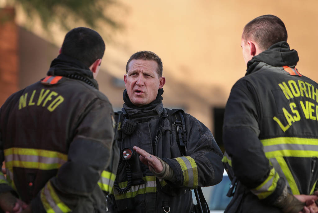 North Las Vegas firefighter Darcy Loewen, center, talks with his colleagues, Andrew Bigger, left, and Brandon Steiner, during a training session at North Las Vegas Fire station 52 in Las Vegas, Tu ...