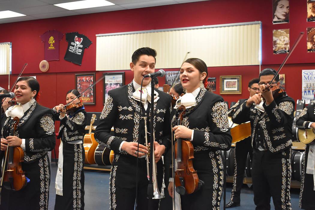 Andy Perez and Haley Tiznado sing a duet with fellow musicians at Del Sol Academy on Dec. 4, 2018. (Rachel Spacek/Las Vegas Review-Journal @Rachel Spacek)