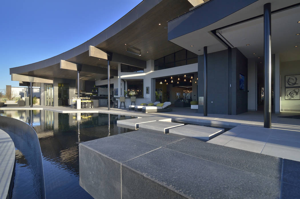 The living room opens to the pool area. (Bill Hughes/Real Estate Millions)