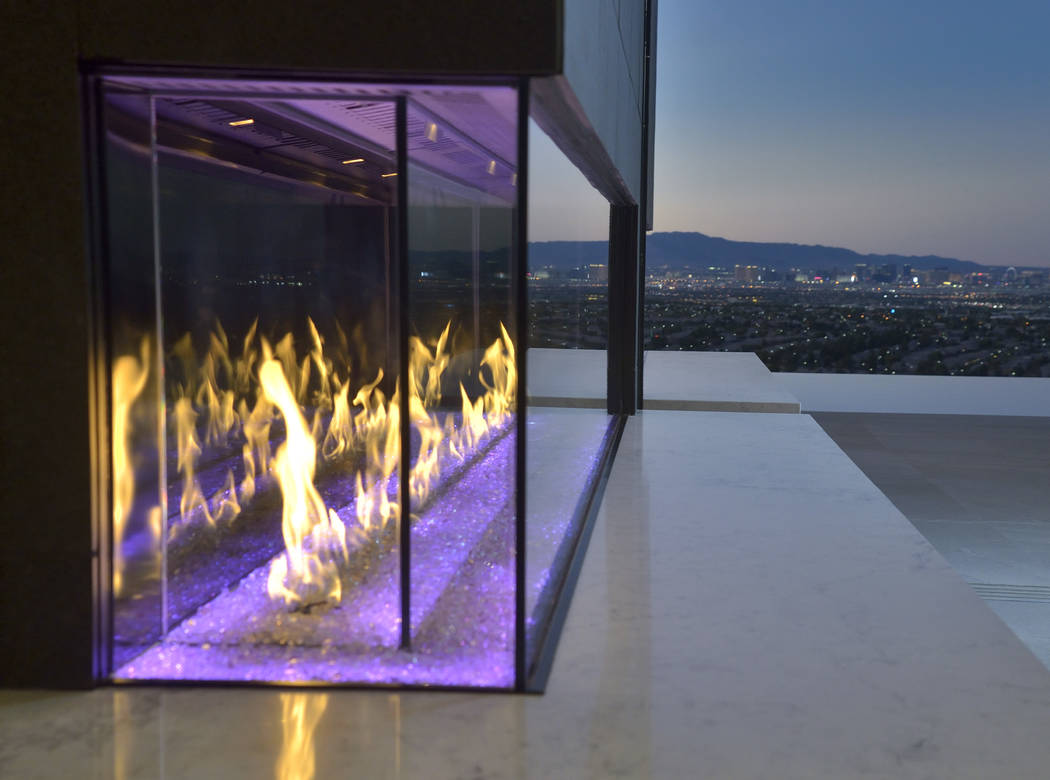 The outdoor fireplace is near the pool area that has views of the Strip. (Bill Hughes/Real Estate Millions)