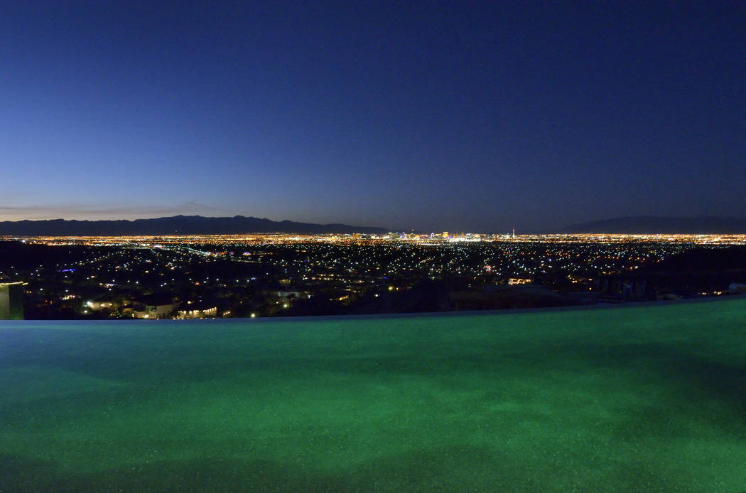 The edge of the pool drops off into the sea of Las Vegas lights. (Bill Hughes/Real Estate Millions)