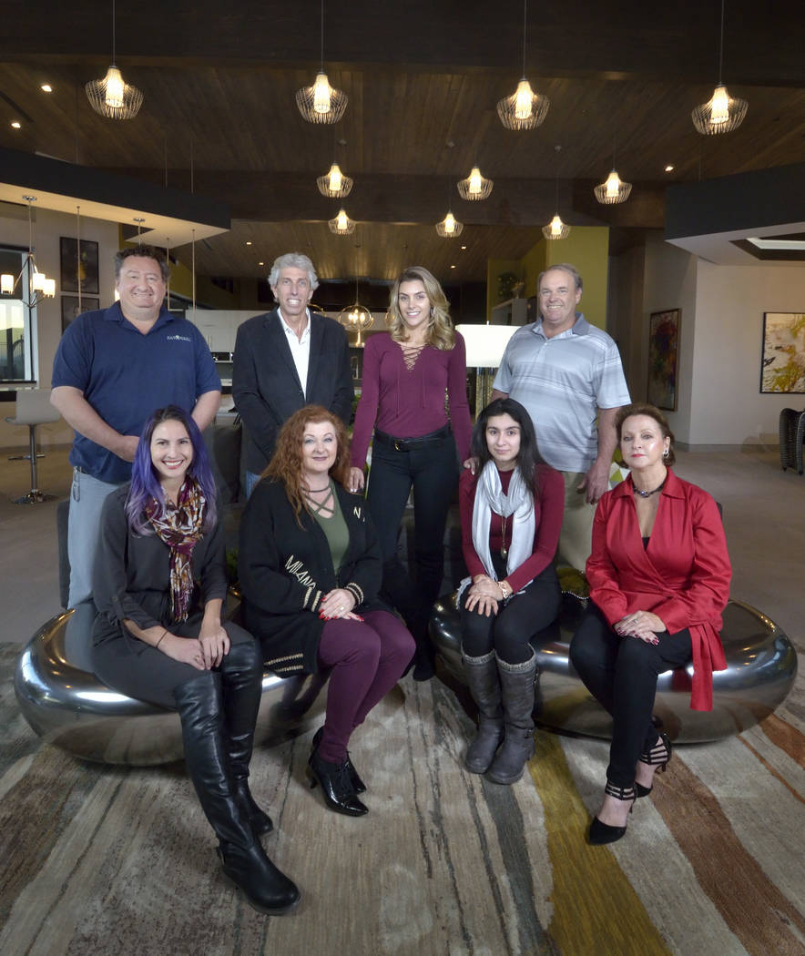 Sun West Custom Homes built the 2019 New American home. They are: back row from left, Carl Martinez, Dan Coletti, Bridgette Slater and Steve Ginther; front row, from left, Jennie Marsh, Patricia M ...