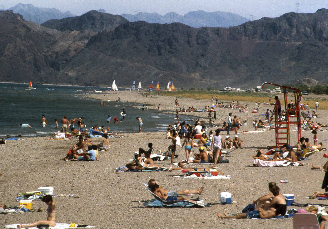 People hang out on Boulder Beach during Memorial Day weekend at Lake Mead National Recreation Area near Boulder City on May 24, 1987. (Gary Thompson/Las Vegas Review-Journal)