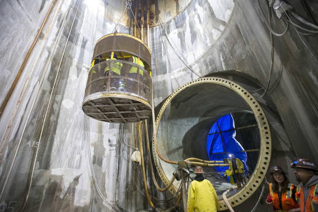 In this Tuesday, Nov. 27, 2018 photo, people are raised from the access shaft during a tour of the Southern Nevada Water Authority's low-lake-level pumping station at Lake Mead National Recreation ...
