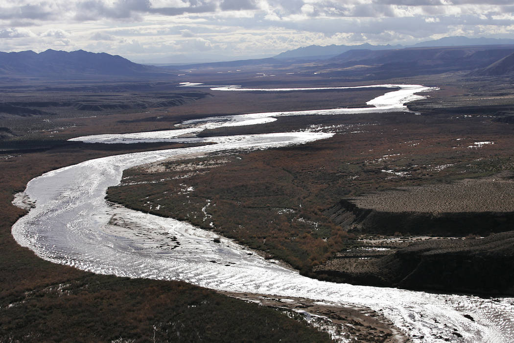 JASON BEAN/LAS VEGAS REVIEW-JOURNAL The swollen Virgin River flows south towards Lake Mead and Las Vegas following heavy rains in the area on Dec. 23, 2010. JASON BEAN JASON BEAN/LAS VEGAS R ...