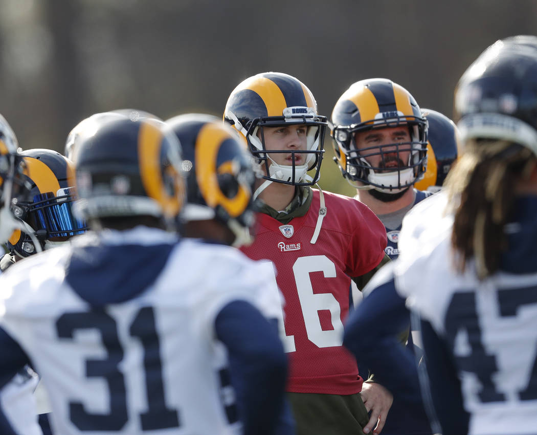 Los Angeles Rams quarterback Jared Goff (16) listens as head coach Sean McVay, not shown, speaks to the team during practice for the NFL Super Bowl 53 football game against the New England Patriot ...