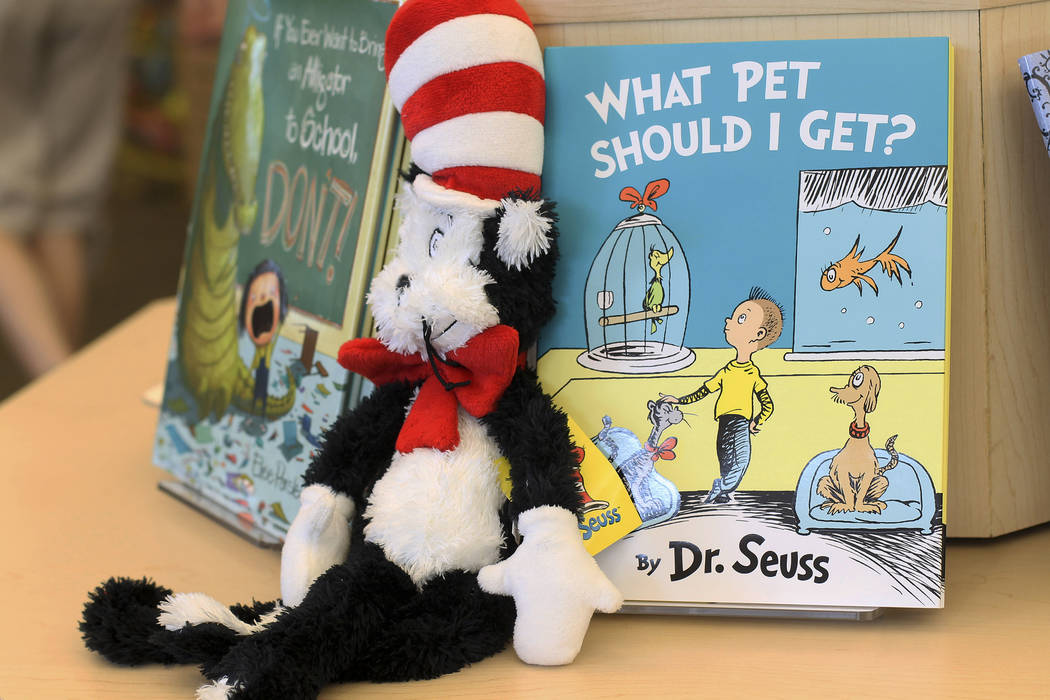 """A plush """"Cat in the Hat"""" toy is displayed next to """"What Pet Should I Get?"""" (AP Photo/Holly Ramer)"""