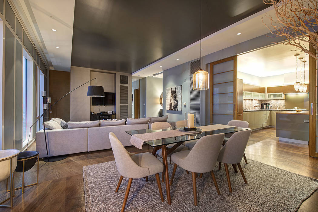 The dining area is next to the kitchen and the living room in unit 4504 in Waldorf Astoria. (Acclaim)