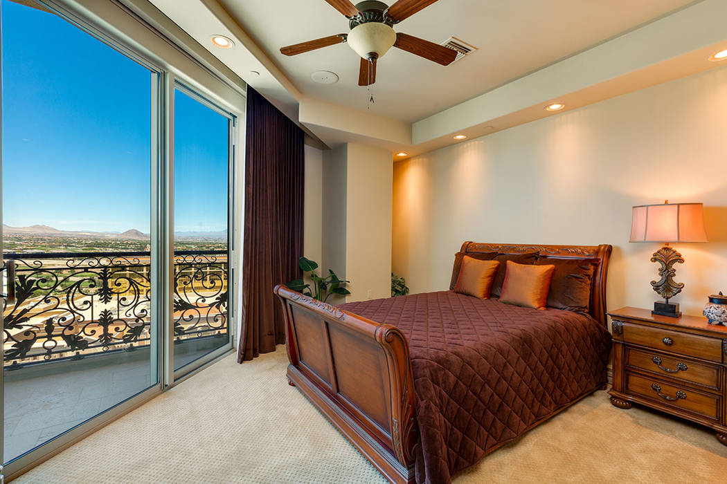 A bedroom in unit 1603 in One Queensridge Place leads to a balcony. (Ivan Sher Group)