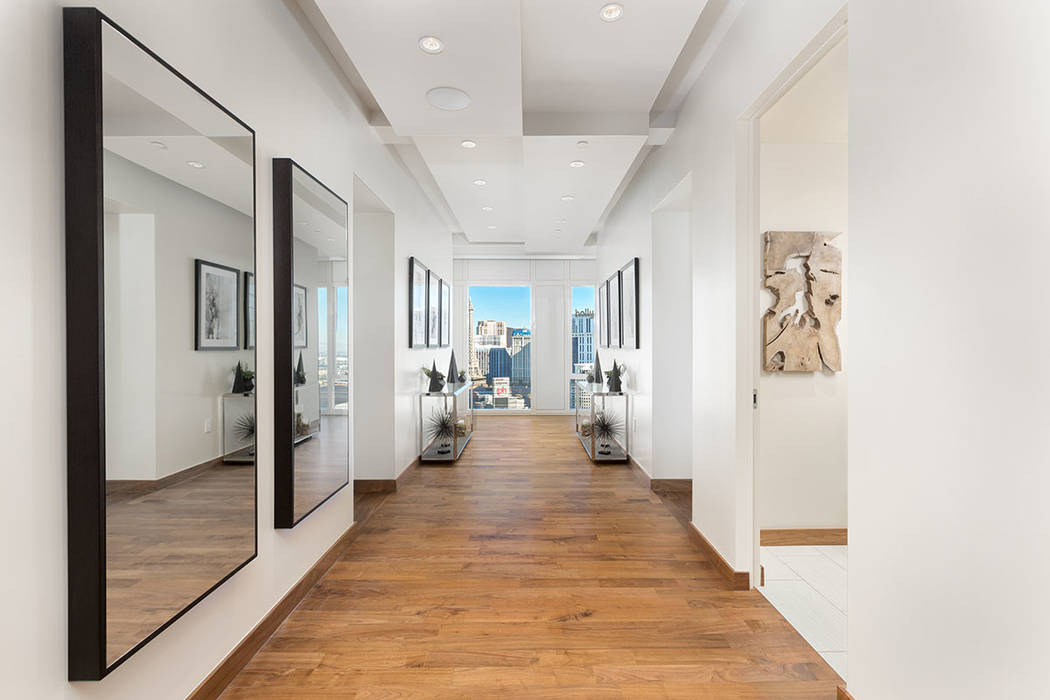 The hallway in Waldorf Astoria unit No. 2403 is lined with mirrors. (Luxury Estates International)