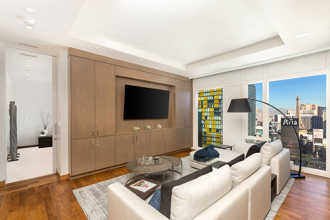 The living room Waldorf Astoria unit No. 2403. (Luxury Estates International)