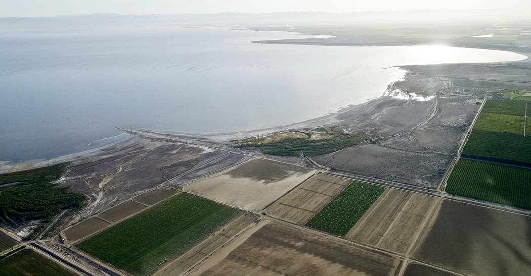 FILE - This May 1, 2015 file photo shows the exposed lake bed of the Salton Sea drying out near Niland, Calif. Work on a multistate plan to address drought on the Colorado River in the U.S. West w ...
