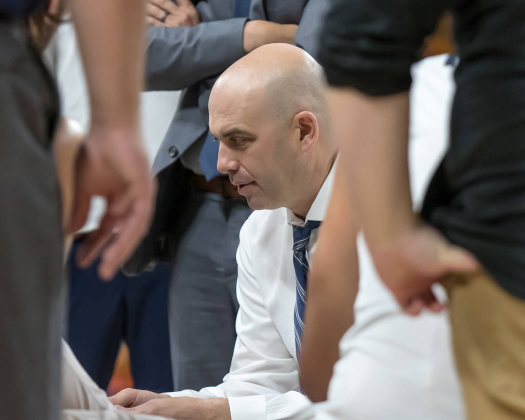 Utah State basketball coach Craig Smith in action during a game. Photo courtesy of Utah State Athletics.