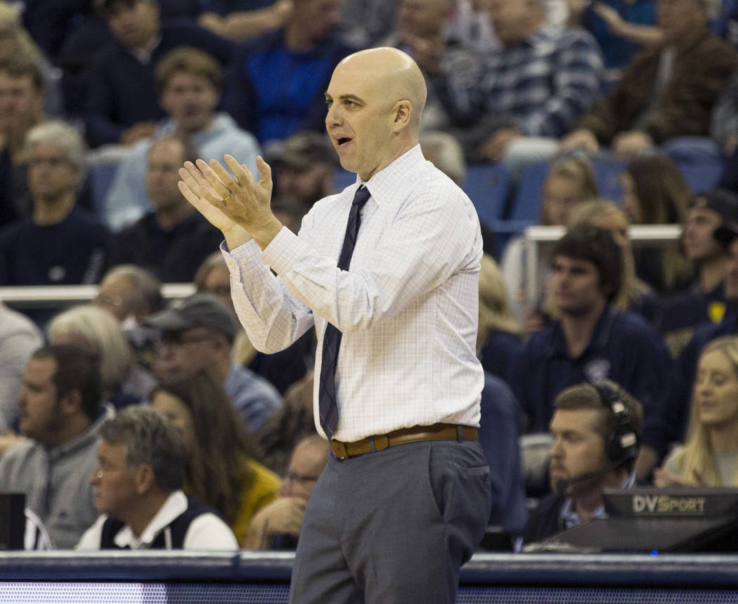 Utah State head coach Craig Smith works the sidelines against Nevada in the first half of an NCAA college basketball game in Reno, Nev., Wednesday, Jan. 2, 2019. (AP Photo/Tom R. Smedes)
