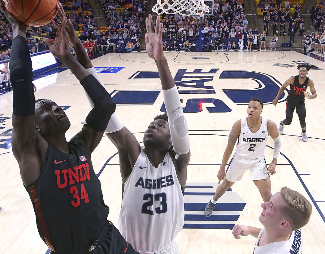 UNLV forward Cheikh Mbacke Diong (34) has his shot blocked by Utah State center Neemias Queta (23) during an NCAA college basketball game Saturday, Feb. 2, 2019, in Logan, Utah. (Eli Lucero/The He ...