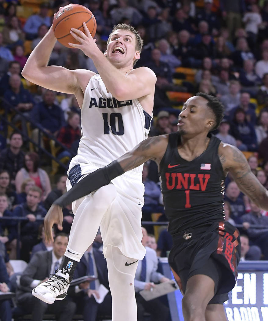 Utah State forward Quinn Taylor (10) drives to the basket as UNLV guard Kris Clyburn (1) defends during an NCAA college basketball game Saturday, Feb. 2, 2019, in Logan, Utah. (Eli Lucero/The Hera ...