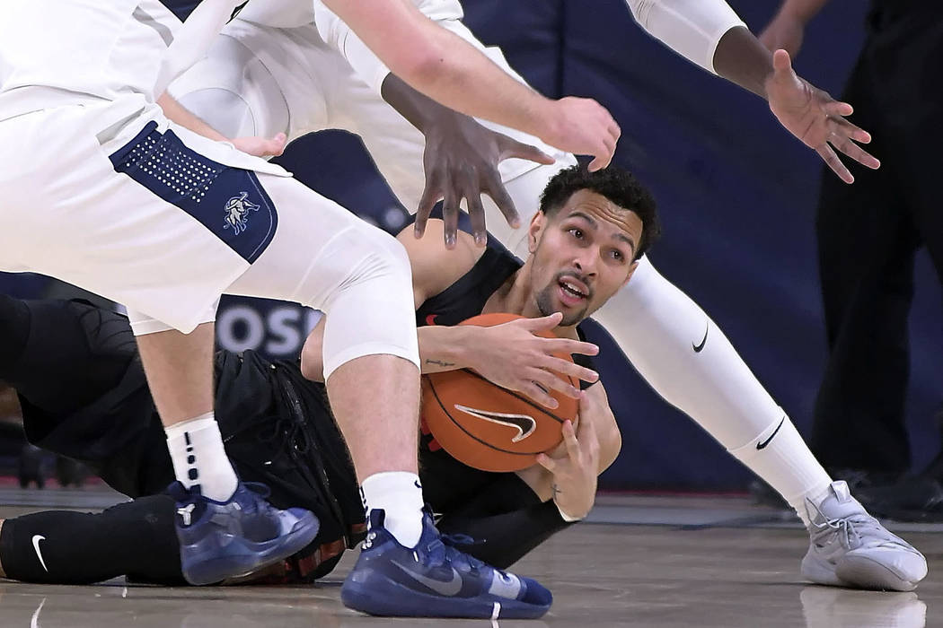 UNLV guard Noah Robotham calls timeout after picking up a loose ball as Utah State players defend during an NCAA college basketball game Saturday, Feb. 2, 2019, in Logan, Utah. (Eli Lucero/The Her ...