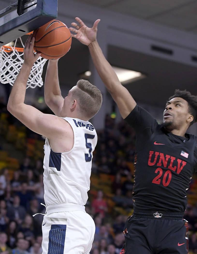 Utah State guard Sam Merrill (5) shoots as UNLV forward Nick Blair (20) defends during an NCAA college basketball game Saturday, Feb. 2, 2019, in Logan, Utah. (Eli Lucero/The Herald Journal via AP)