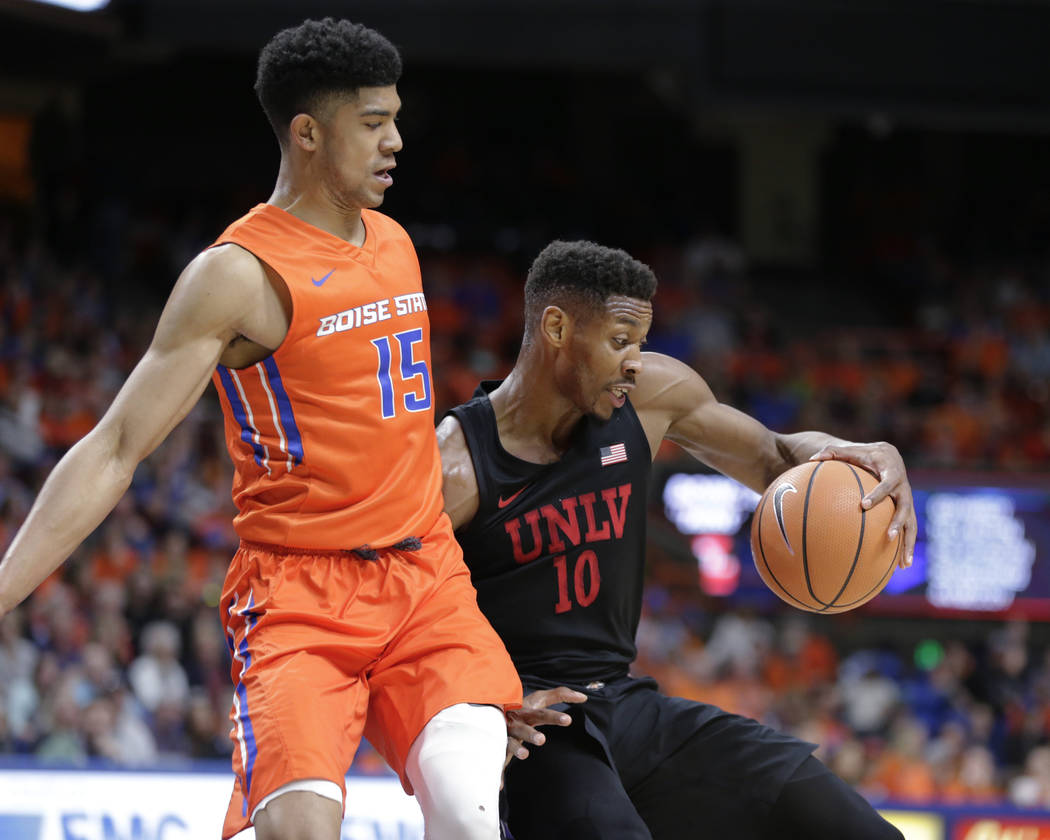 UNLV's Shakur Juiston (10) moves the ball against Boise State's Chandler Hutchison (15) during the first half of an NCAA college basketball game in Boise, Idaho, Saturday, Feb. 3, 2018. (AP Photo/ ...