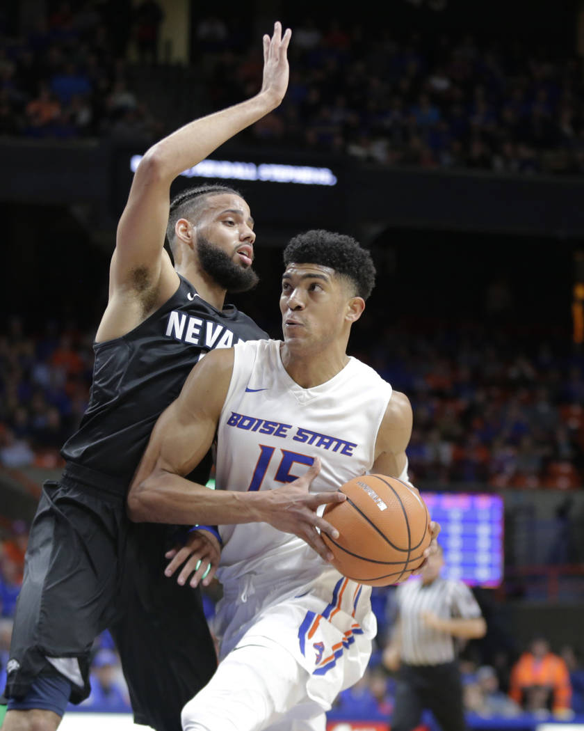 Boise State's Chandler Hutchison (15) drives past Nevada's Cody Martin during the second half of an NCAA college basketball game in Boise, Idaho, Wednesday, Feb. 14, 2018. Nevada won 77-72. (AP Ph ...