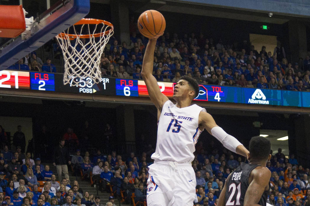 Boise State guard Chandler Hutchison goes up for a dunk past San Diego State forward Malik Pope during an NCAA college basketball game Saturday, Jan. 13, 2018, in Boise, Idaho. Hutchison scored 44 ...
