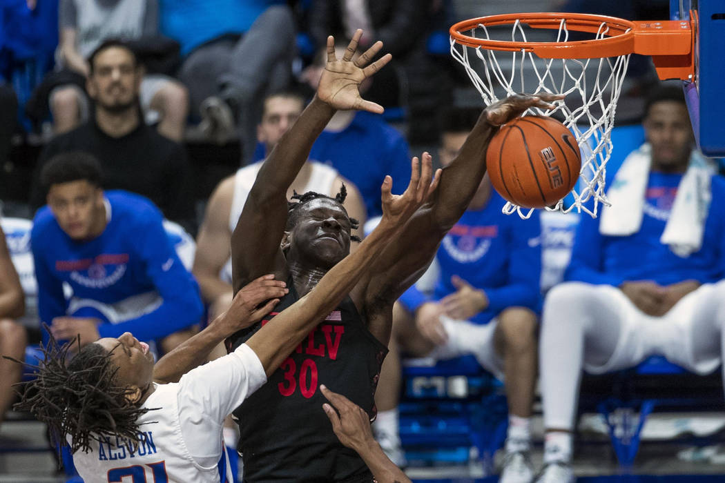 Boise State guard Derrick Alston drives to the basket but has his shot blocked by UNLV forward Jonathan Tchamwa Tchatchoua during the second half of an NCAA college basketball game Wednesday, Feb. ...