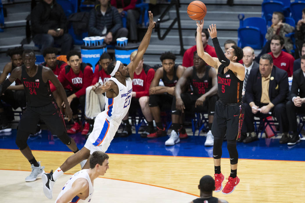 UNLV guard Noah Robotham pulls up for a 3-pointer while defended by Boise State's RJ Williams during the second half of an NCAA college basketball game Wednesday, Feb. 6, 2019, in Boise, Idaho. (D ...