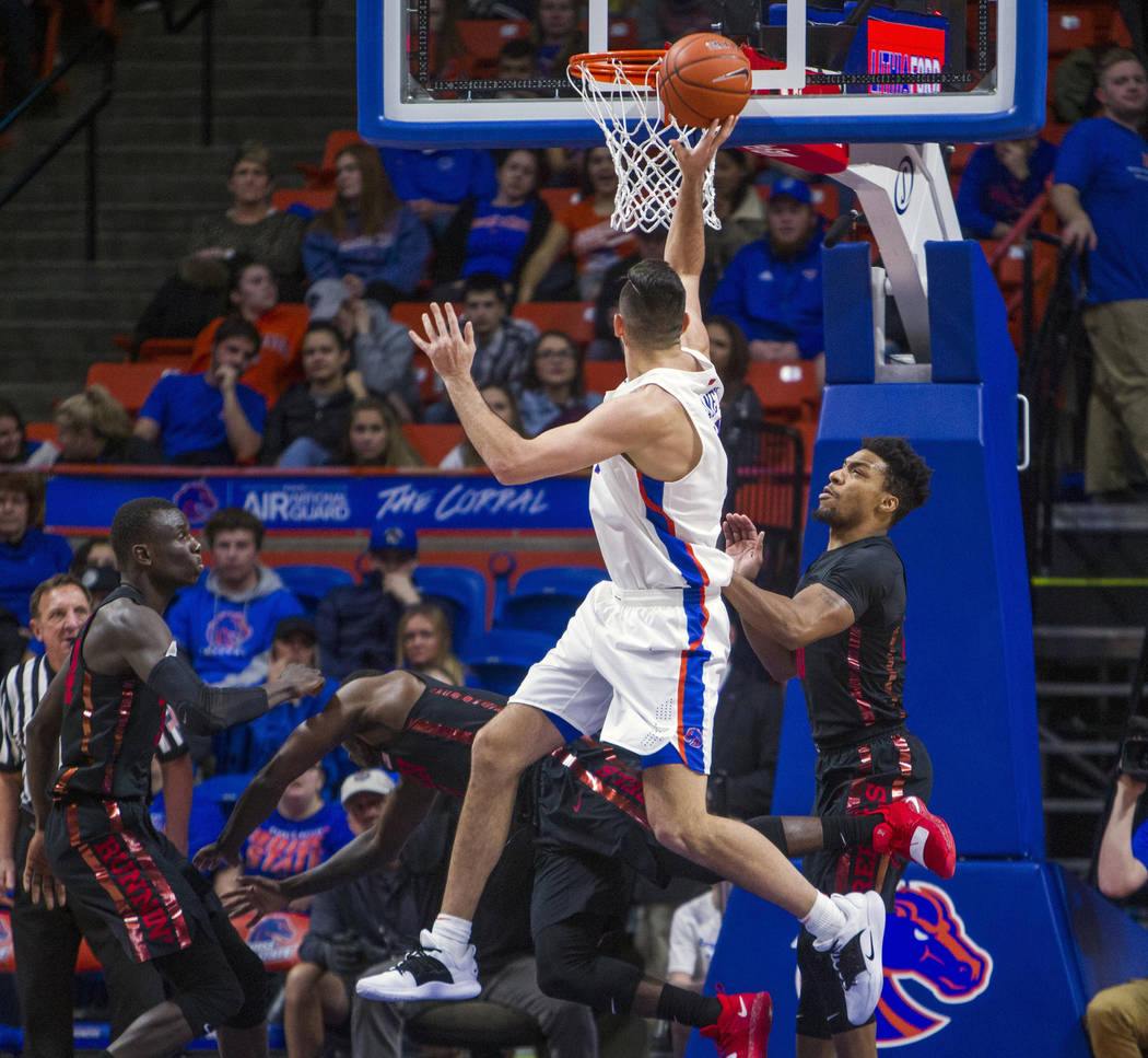 Boise State forward Zach Haney hits an awkward jumper after being fouled by UNLV forward Cheikh Mbacke Diong during the first half of an NCAA college basketball game Wednesday, Feb. 6, 2019, in Bo ...