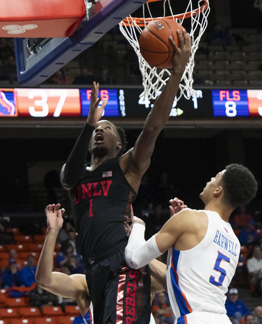 UNLV guard Kris Clyburn drives and scores while defended by Boise State's Malek Harwell during the first half of an NCAA college basketball game Wednesday, Feb. 6, 2019, in Boise, Idaho. (Darin Os ...
