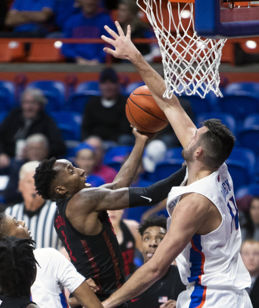 Boise State forward Zach Haney blocks a shot by UNLV guard Kris Clyburn during the first half of an NCAA college basketball game Wednesday, Feb. 6, 2019, in Boise, Idaho. (Darin Oswald/Idaho State ...