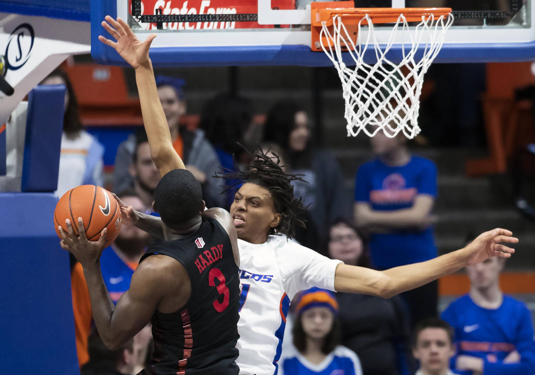 Boise State guard Derrick Alston fouls UNLV guard Amauri Hardy on a drive during the second half of an NCAA college basketball game Wednesday, Feb. 6, 2019, in Boise, Idaho. (Darin Oswald/Idaho St ...