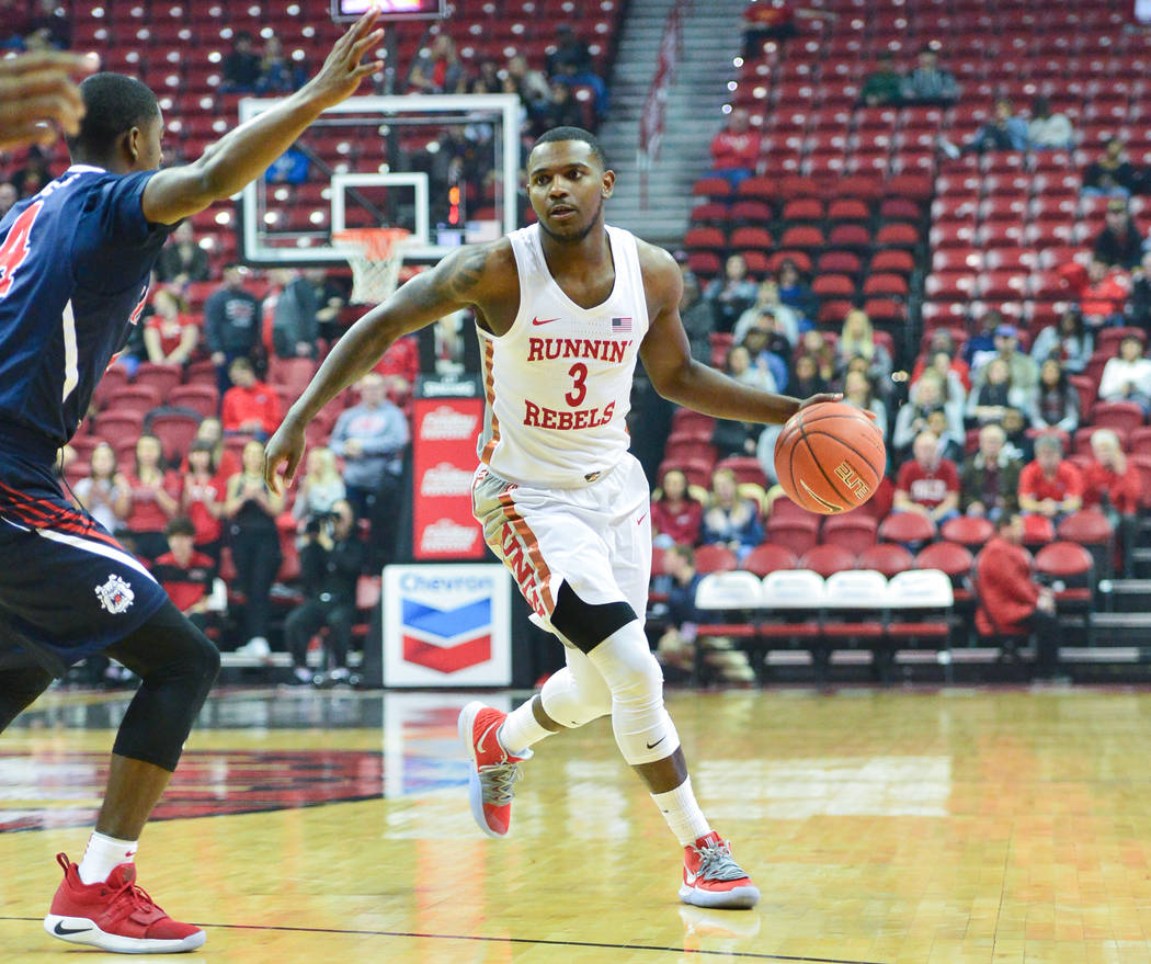 UNLV Rebels guard Amauri Hardy (3) looks for an open teammate during the first half of a game between UNLV and Fresno State at the Thomas & Mack Center in Las Vegas, on Saturday, Feb. 9, 2019. ...