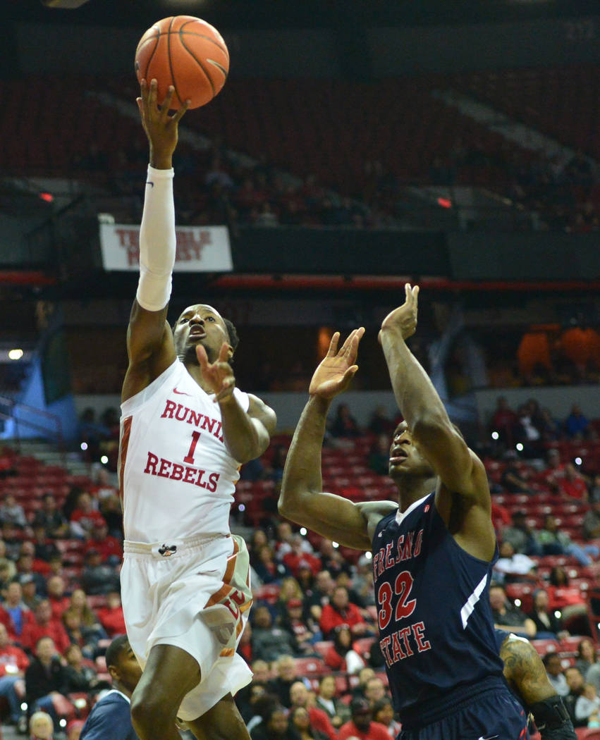 UNLV Rebels guard Kris Clyburn (1) shoots the ball over Fresno State Bulldogs forward Nate Grimes (32) during the first half of a game between UNLV and Fresno State at the Thomas & Mack Center ...