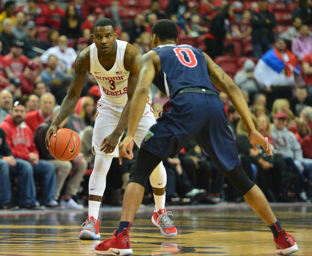 UNLV Rebels guard Amauri Hardy (3) starts a play while being guarded by Fresno State Bulldogs guard New Williams (0) during the first half of a game between UNLV and Fresno State at the Thomas &am ...