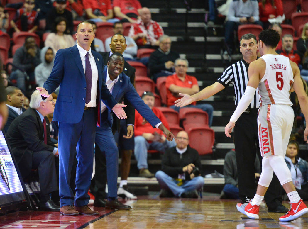 Fresno State Bulldogs head coach Justin Hutson, left, reacts to a call during the second half of a game between UNLV and Fresno State at the Thomas & Mack Center in Las Vegas, on Saturday, Feb ...