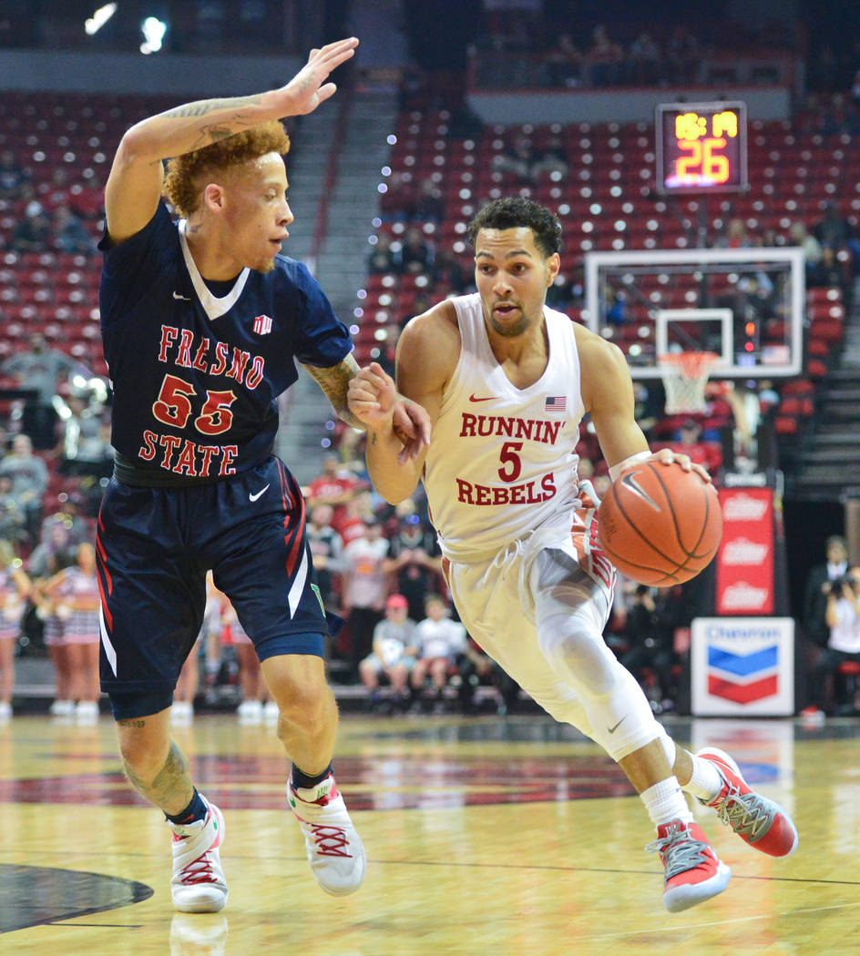 UNLV Rebels guard Noah Robotham (5) drives the ball around Fresno State Bulldogs guard Noah Blackwell (55) during the first half of a game between UNLV and Fresno State at the Thomas & Mack Ce ...