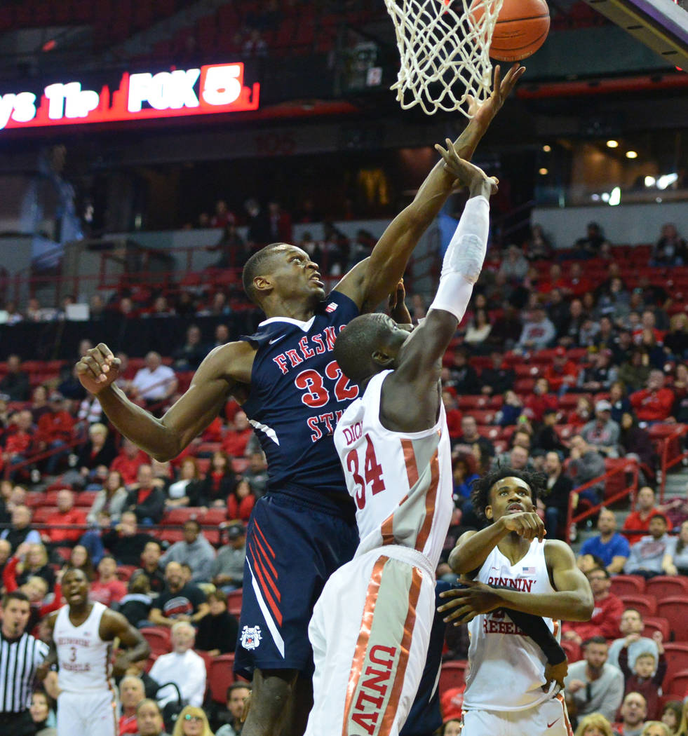 Fresno State Bulldogs forward Nate Grimes (32) and UNLV Rebels forward Cheikh Mbacke Diong (34) battle for a rebound during the second half of a game between UNLV and Fresno State at the Thomas &a ...