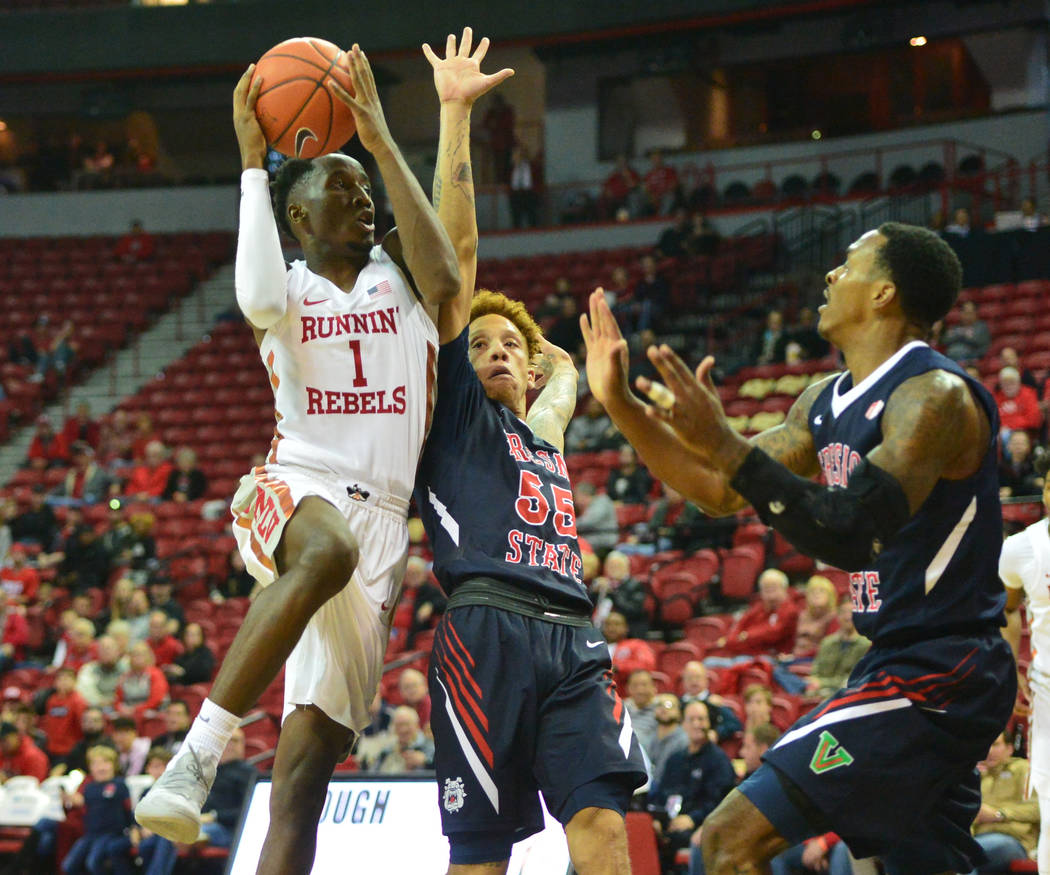UNLV Rebels guard Kris Clyburn (1) goes up for a shot over Fresno State Bulldogs guard Noah Blackwell (55) of a game between UNLV and Fresno State at the Thomas & Mack Center in Las Vegas, on ...