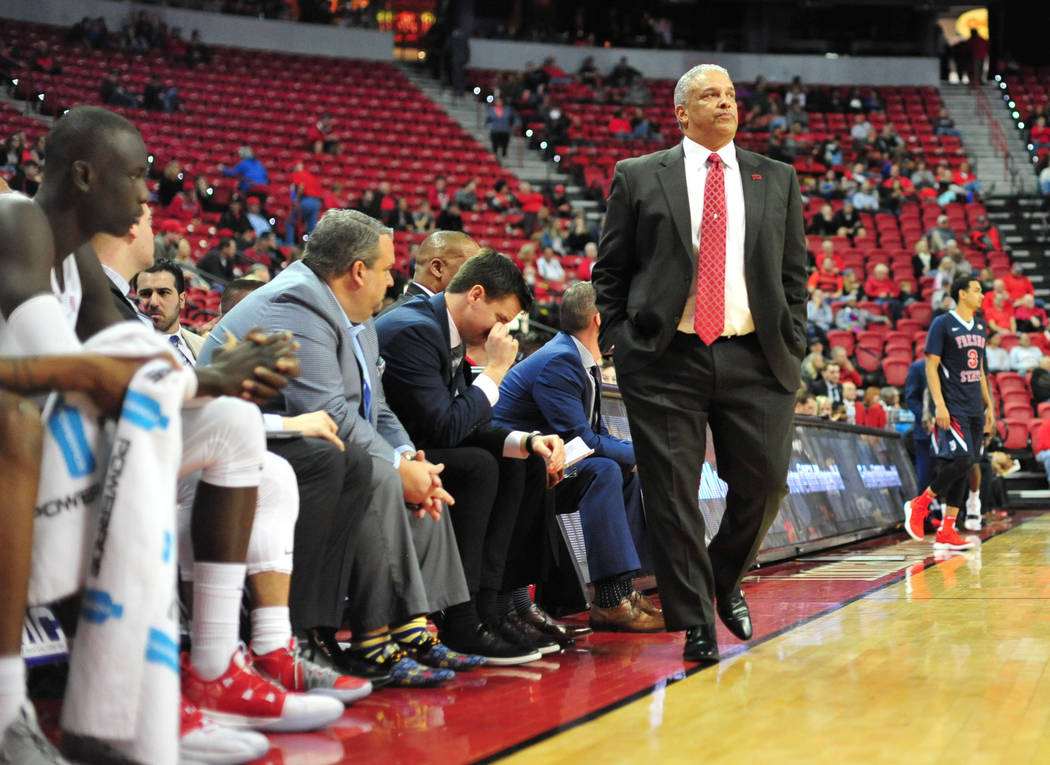 UNLV Rebels head coach Marvin Menzies walks the sideline during the second half of a game between UNLV and Fresno State at the Thomas & Mack Center in Las Vegas, on Saturday, Feb. 9, 2019. Fre ...