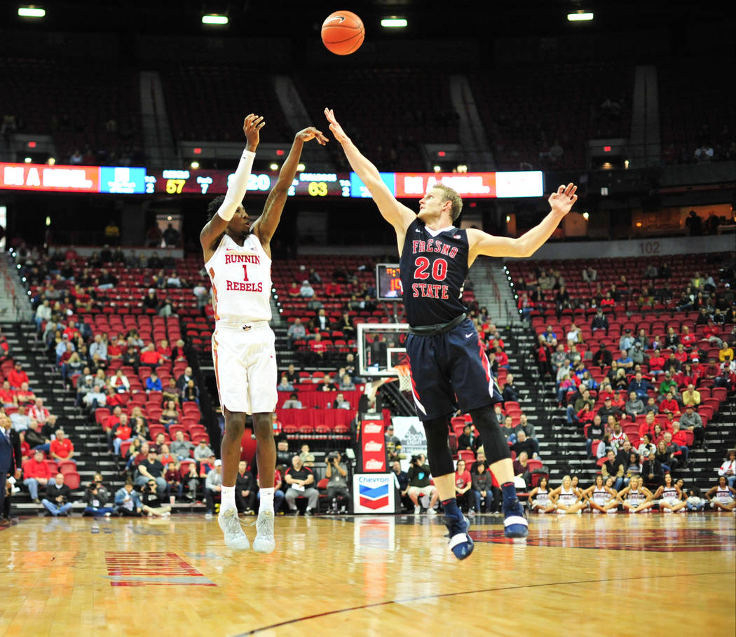 UNLV Rebels guard Kris Clyburn (1) takes a three-point-shot over Fresno State Bulldogs forward Sam Bittner (20) of a game between UNLV and Fresno State at the Thomas & Mack Center in Las Vegas ...