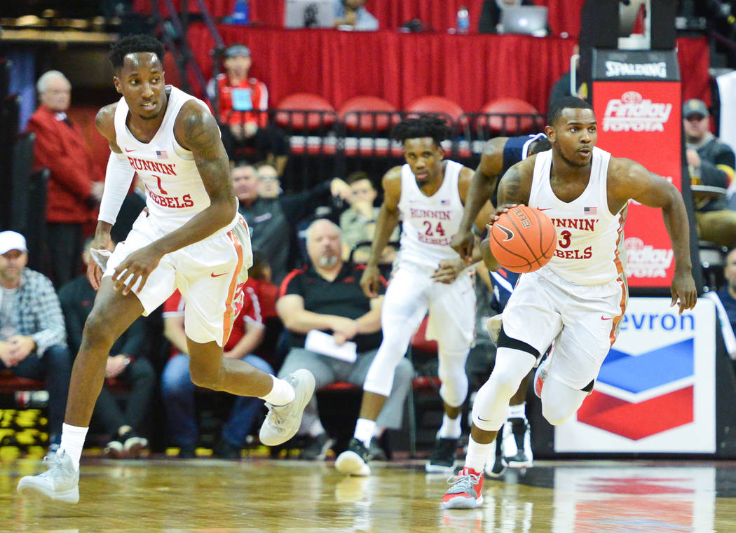 UNLV Rebels guard Amauri Hardy (3) leads UNLV Rebels guard Kris Clyburn (1) and UNLV Rebels forward Joel Ntambwe (24) down the the court on an offensive possession during the second half of a game ...