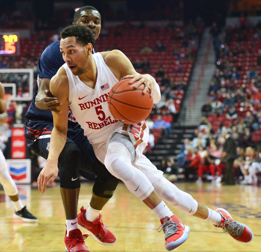 UNLV Rebels guard Noah Robotham (5) dribbles the ball around the edge during the first half of a game between UNLV and Fresno State at the Thomas & Mack Center in Las Vegas, on Saturday, Feb. ...
