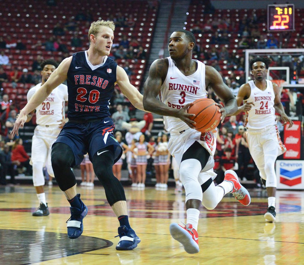 UNLV Rebels guard Amauri Hardy (3) drives the ball around Fresno State Bulldogs forward Sam Bittner (20) of a game between UNLV and Fresno State at the Thomas & Mack Center in Las Vegas, on Sa ...