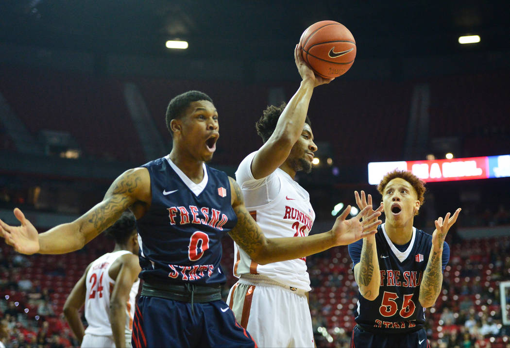 Fresno State Bulldogs guard New Williams (0) and guard Noah Blackwell (55) react to a call while UNLV Rebels forward Nick Blair (20) walks past during the first half of a game between UNLV and Fre ...