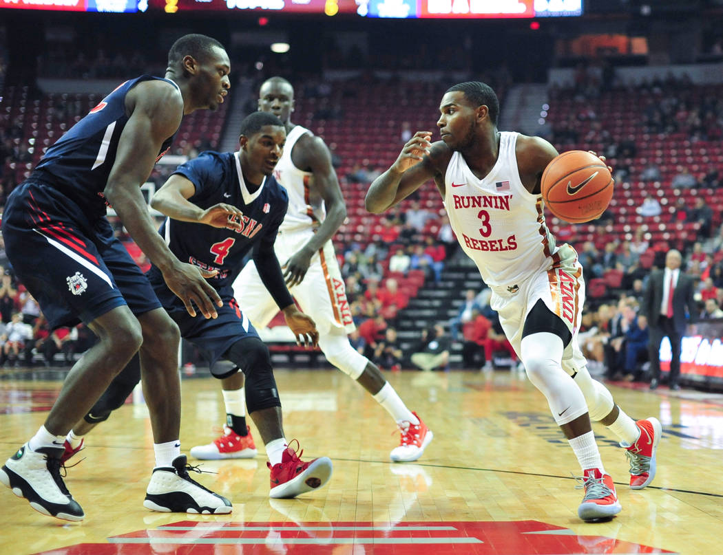UNLV Rebels guard Amauri Hardy (3) drives the ball to the basket during the first half of a game between UNLV and Fresno State at the Thomas & Mack Center in Las Vegas, on Saturday, Feb. 9, 20 ...