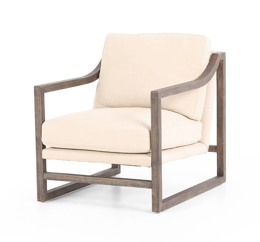Four Hands' Malcolm Chair is shapely in structure, clean in contrast. Neutral ivory seating of rich top-grain leather is framed within a rubbed brown parawood frame, with sloped arms for added dra ...